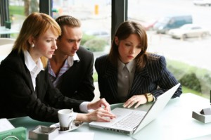 three_business_people_at_laptop